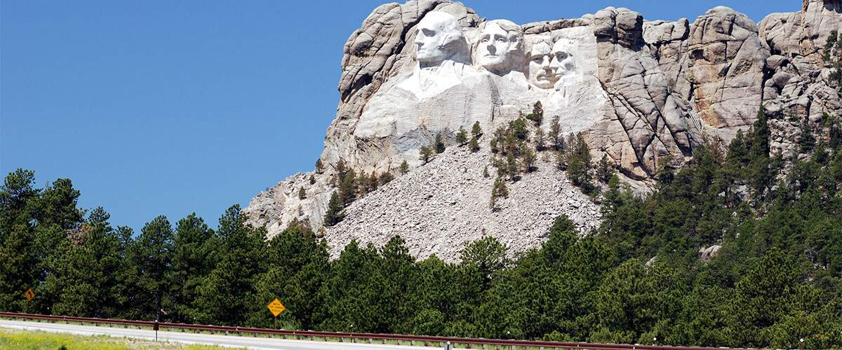 Photo of Mount Rushmore from Highway 16 near the monument's entrance.